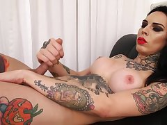 Tattooed connected with shemale wanks her dick