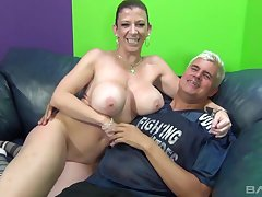 Lustful cougar Sarah Jay fucking a tattooed guy in excess of the couch