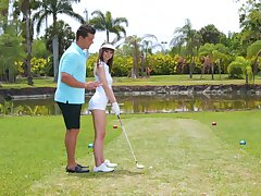 Golf crammer teaches amateur Shae Celestine how anent handle a shaft