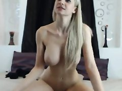 blonde beauty with big tits rides dildo