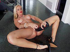 Sultry MILF Sandy uses a huge fake black dick in her clam