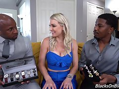 Blondie gets shared by a bowels of black hunks with huge dicks