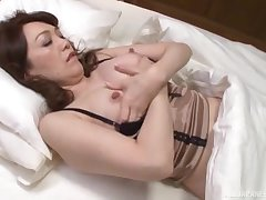 Sex-mad Japanese MILF spreads her legs to masturbate and gets fucked