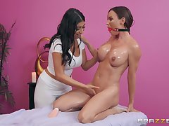 During burnish apply massage Diamond Foxxx gets her pussy pleased by a girl