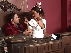 Keisha Kane wears costume for nurse and sits upstairs a hard shaft upstairs the bed