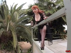 Mature Red XXX joking outside on the patio